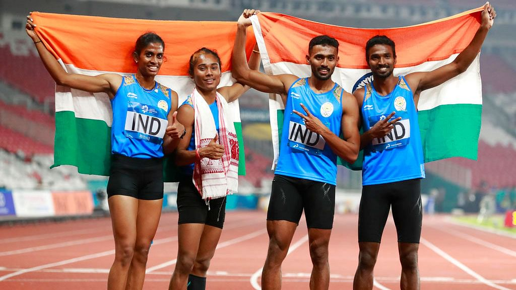 India's 4x400m mixed relay team celebrate after winning a silver medal at the Asian Games.