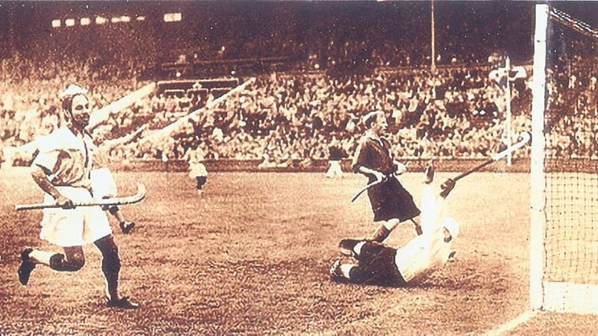 Balbir Singh Sr (left) scoring his first goal against Great Britain at the London Olympics in 1948.