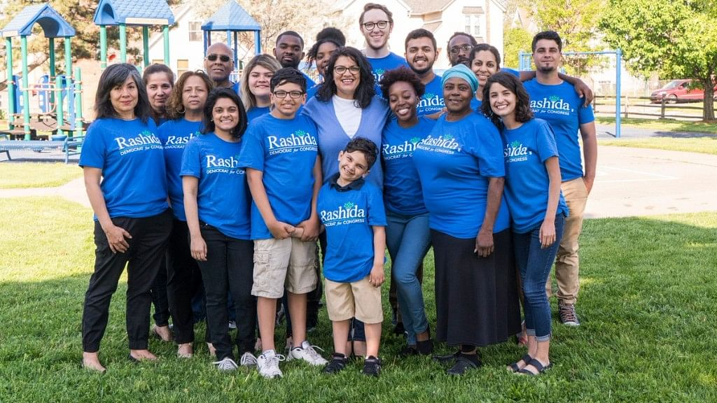 Rashida Tlaib (center), a mother of two and daughter of Palestinian immigrants once detained for disrupting a Donald Trump speech, made history on 8 August 2018, poised to become the first Muslim woman in US Congress.
