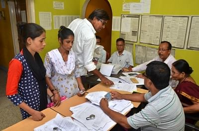 Guwahati: People who were not included in the complete draft National Register of Citizens (NRC), collect application forms to re-apply for their names to be included in the NRC draft, at NRC Sewa Kendra (NSK) Hatigaon, in Guwahati on Aug 20, 2018. (Photo: IANS)