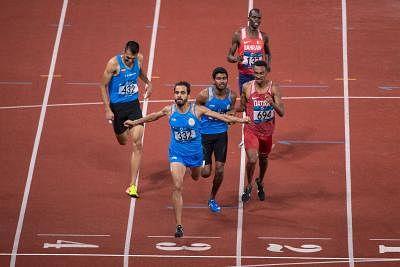 JAKARTA, Aug. 28, 2018 (Xinhua) -- Manjit Singh (2nd L) of India celebrates after men
