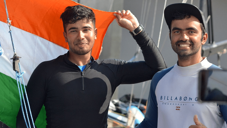 Ganapathy (L) Thakkar (R) pose for a photo after clinching bronze at the Asiad.