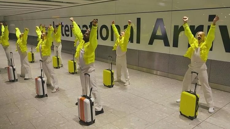Staff at Heathrow airport perform a tribute to Freddie Mercury.
