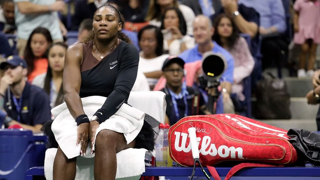 Serena Williams takes a break during a changeover against Naomi Osaka during the women's final of the US Open on Saturday.