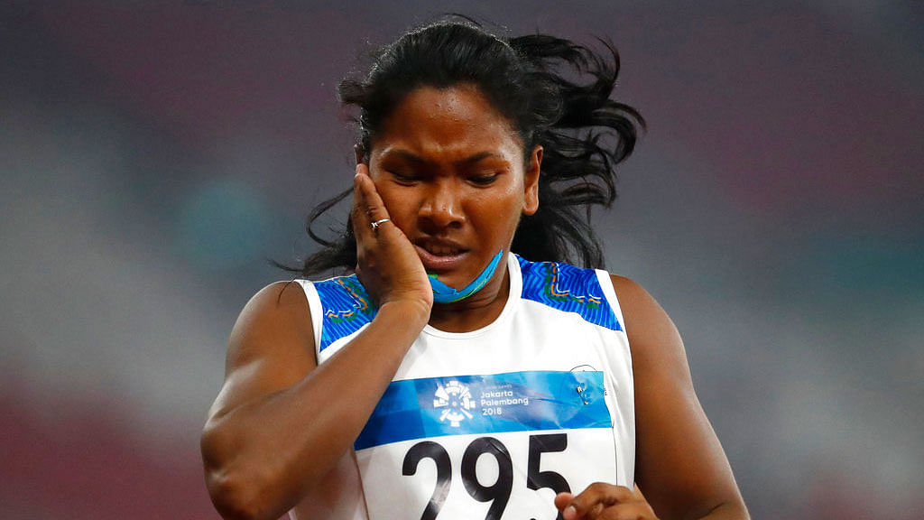Swapna Barman reacts after her heptathlon 200m event at the Asian Games.