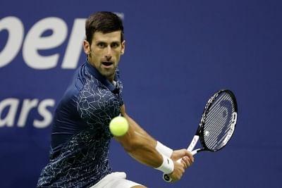 NEW YORK, Sept. 8, 2018 (Xinhua) -- Novak Djokovic of Serbia hits a return during the men