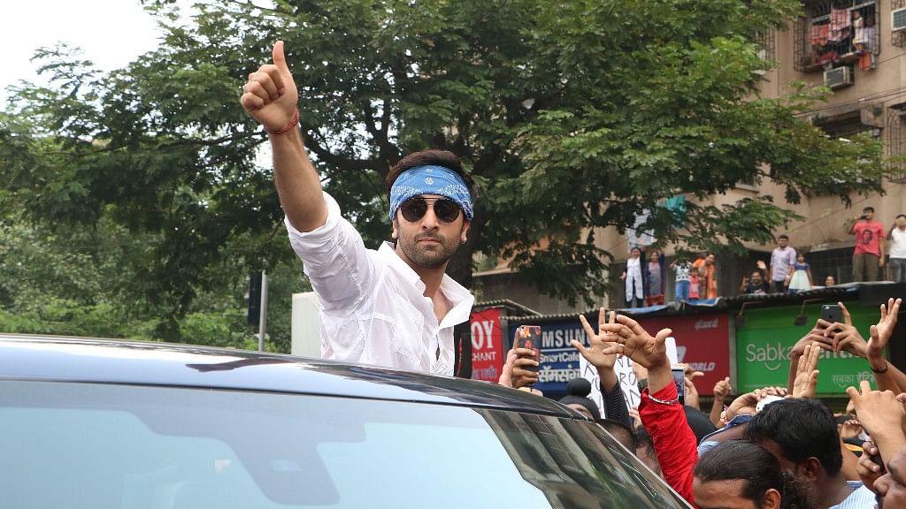 Ranbir Kapoor joins the crowds during the Ganpati visarjan procession.