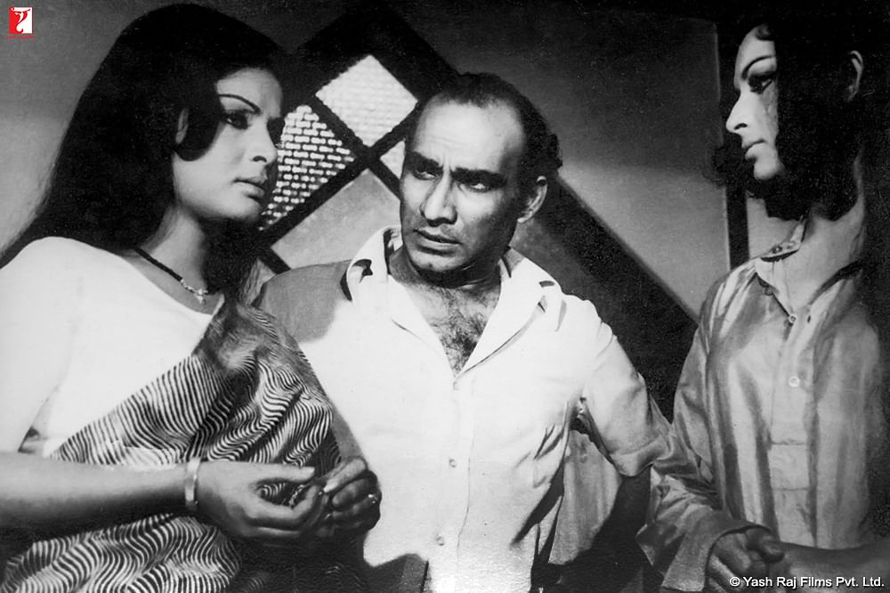 Raakhee Gulzar, Yash Chopra and Sharmila Tagore on the sets of <i>Daag.</i>