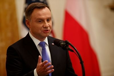 WASHINGTON D.C., Sept. 19, 2018 (Xinhua) -- Polish President Andrzej Duda addresses a joint press conference with U.S. President Donald Trump (unseen) at the White House in Washington D.C. Sept. 18, 2018. Donald Trump said on Tuesday that the U.S. was weighing the idea of establishing a permanent military base in Poland, a proposal raised by the visiting Polish leader. (Xinhua/Ting Shen/IANS)