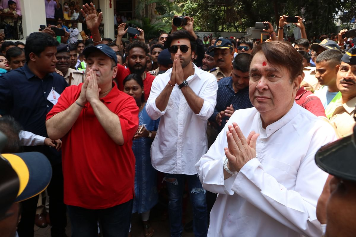 Ranbir Kapoor, Randhir Kapoor and Rajiv Kapoor pray before the idol of Ganpati at RK Studios.
