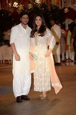 Actor Shah Rukh Khan with his wife Gauri Khan. (Photo: IANS)