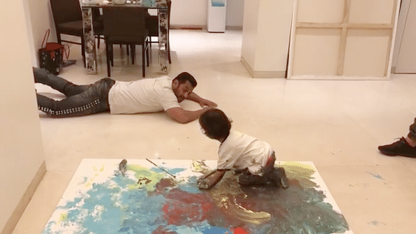 Salman Khan trains his nephew Ahil in the art of painting.