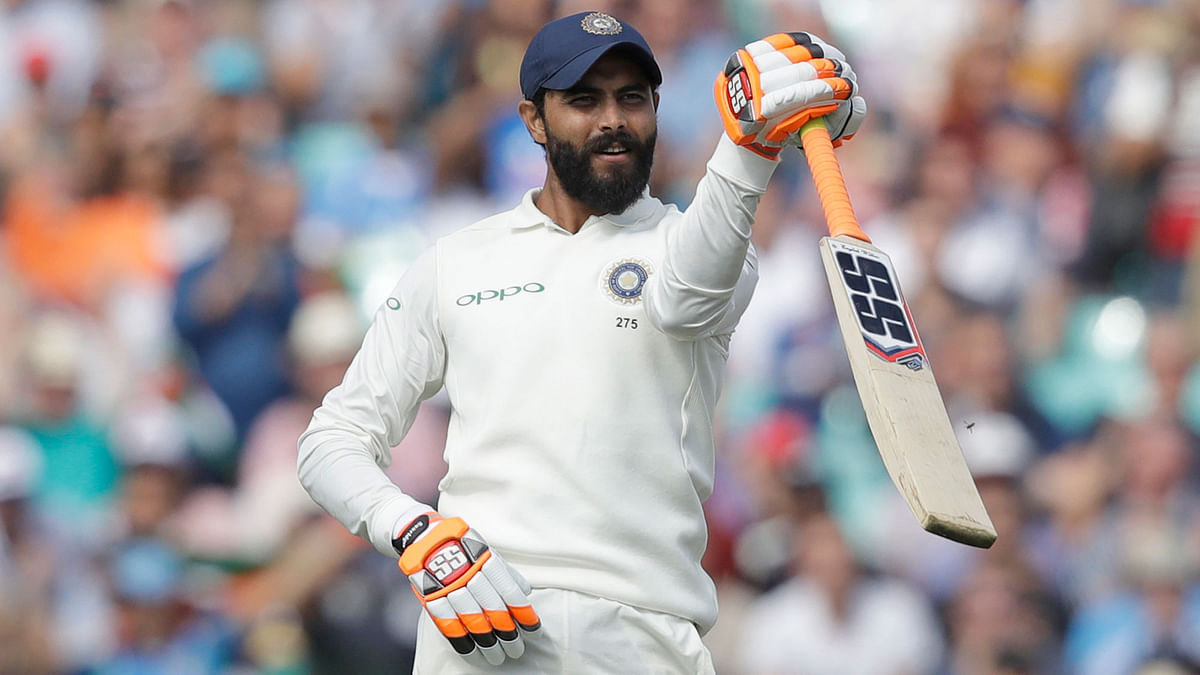 India's Ravindra Jadeja celebrates reaching 50 runs during the fifth cricket test match of a five match series between England and India at the Oval cricket ground in London.