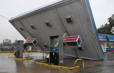 WASHINGTON, Sept. 15, 2018 (Xinhua) -- A gas station near the coastline was damaged by the storm in North Carolina, the United States, on Sept. 14, 2018. At least five people have been killed so far in the aftermath of Hurricane Florence which was downgraded Friday afternoon to a tropical storm with winds of 70 mph (110 km/h) along the U.S. East Coast. (Xinhua/Liu Jie/IANS)
