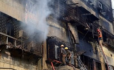 Kolkata: Firemen during firefighting operations at Bagri market where a fire broke out on Sunday; in Kolkata on Sept 19, 2018. (Photo: Kuntal Chakrabarty/IANS)