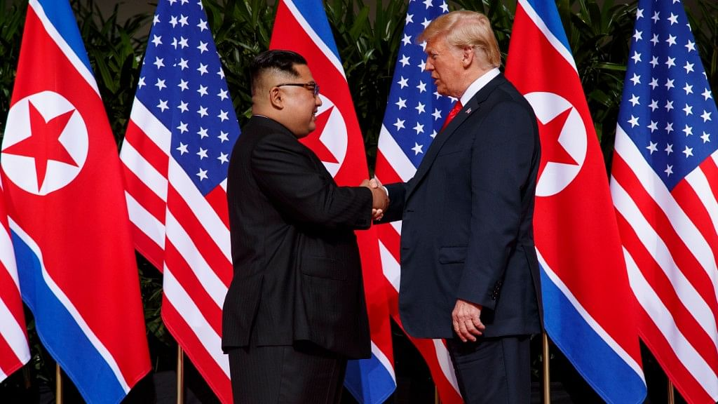 President Donald Trump meets with North Korean leader Kim Jong Un on Sentosa Island in Singapore during their first summit.