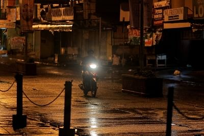 ISABELA, Sept. 14, 2018 (Xinhua) -- A resident on his motorcycle braves the rain in Isabela Province, Philippines, Sept. 14, 2018. The Philippines has started evacuating over 800,000 residents in several provinces in the northern Philippines who are living in the path of the strong typhoon that is expected to make a landfall this Saturday. (Xinhua/Rouelle Umali/IANS)