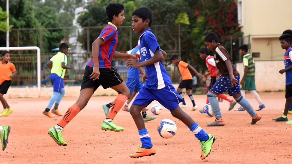 On any given evening, over 75 kids practice in the Gowthamapuram stadium.