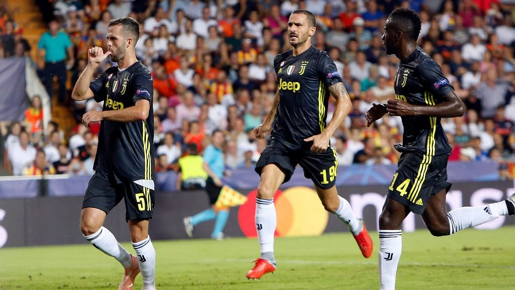 Juventus midfielder Miralem Pjanic (left) celebrates with teammates Leonardo Bonucci and Blaise Matuidi (right) after scoring  a penalty during the Champions League match against Valencia on Wednesday.