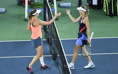 WUHAN, Sept. 25, 2018 (Xinhua) -- Caroline Wozniacki (R) of Denmark reacts with Rebecca Peterson of Sweden after their singles second round match at the 2018 WTA Wuhan Open tennis tournament in Wuhan of central China