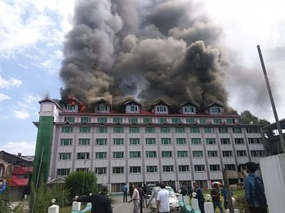 Srinagar: Massive fire breaks out at the top floor of the multi-storeyed Pamposh Hotel on Residency Road, in Srinagar on Sept 15, 2018. The building houses offices of some news channels and business establishments. There were no immediate reports of casualties and the cause of the fire remains unknown. (Photo: IANS)