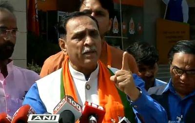 New Delhi: Gujarat Chief Minister and BJP leader Vijay Rupani addresses a press conference, in New Delhi on Sept 9, 2018. (Photo: IANS/BJP)