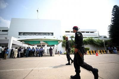 ISLAMABAD, Sept. 4, 2018 (Xinhua) -- Pakistani policemen walk past the National Assembly building during the presidential election in Islamabad, capital of Pakistan on Sept. 4, 2018. Polling for presidential election kicked off Tuesday in Pakistan with three candidates competing for the slot of the 13th president of the country for the next five-year term.  (Xinhua/Ahmad Kamal/IANS)