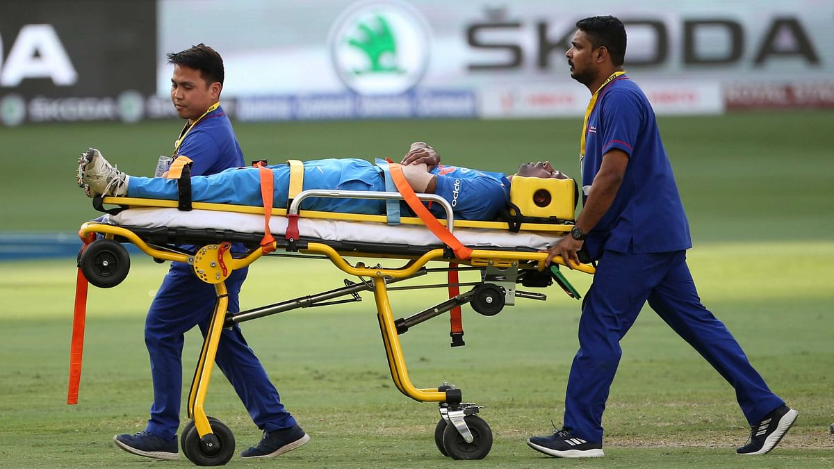 India's Hardik Pandya is taken out of the field on a stretcher after he fell after bowling a delivery during the ODI  match  between India and Pakistan in Dubai.