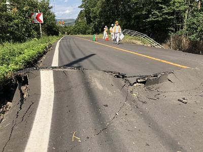 HOKKAIDO, Sept. 6, 2018 (Xinhua) -- Photo taken on Sept. 6, 2018 shows a damaged road after an earthquake in the town of Atsuma, Hokkaido prefecture, Japan. Nine people were confirmed dead and 300 people were injured after a strong earthquake rocking Japan