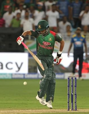 Dubai: Tamim Iqbal of Bangladesh plays with one hand after fracturing his left wrist during Asia Cup 2018 Group B match between Bangladesh and Sri Lanka at Dubai International Cricket Stadium in Dubai, UAE on Sept 15, 2018. Tamim Iqbal has been ruled out of the Asia Cup after fracturing his left wrist. (Photo: Surjeet Yadav/IANS)