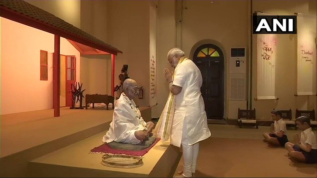 PM Modi pays his respects to a Mahatma Gandhi statue at the newly built Mahatma Gandhi Museum at the Alfred High School.