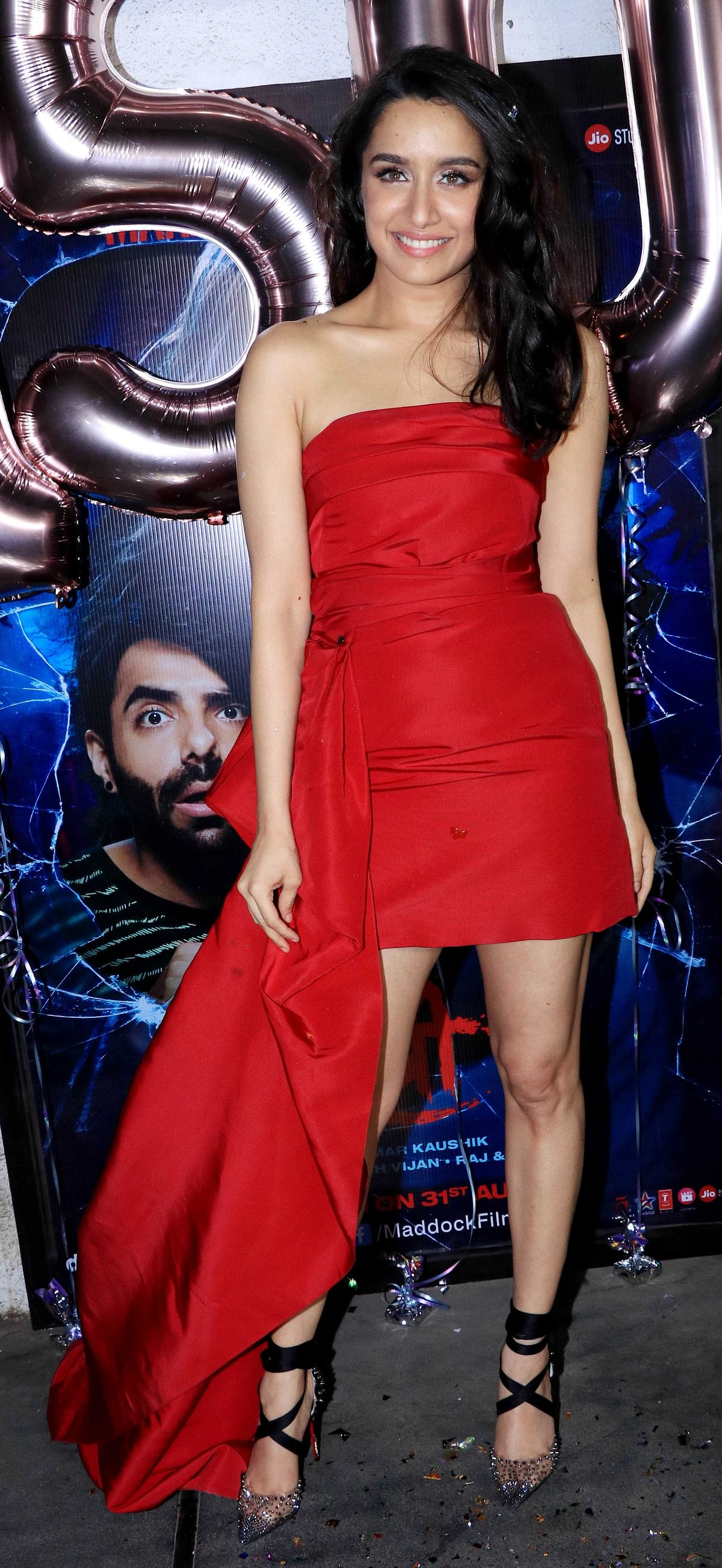 Shraddha Kapoor poses in a glitzy red dress.