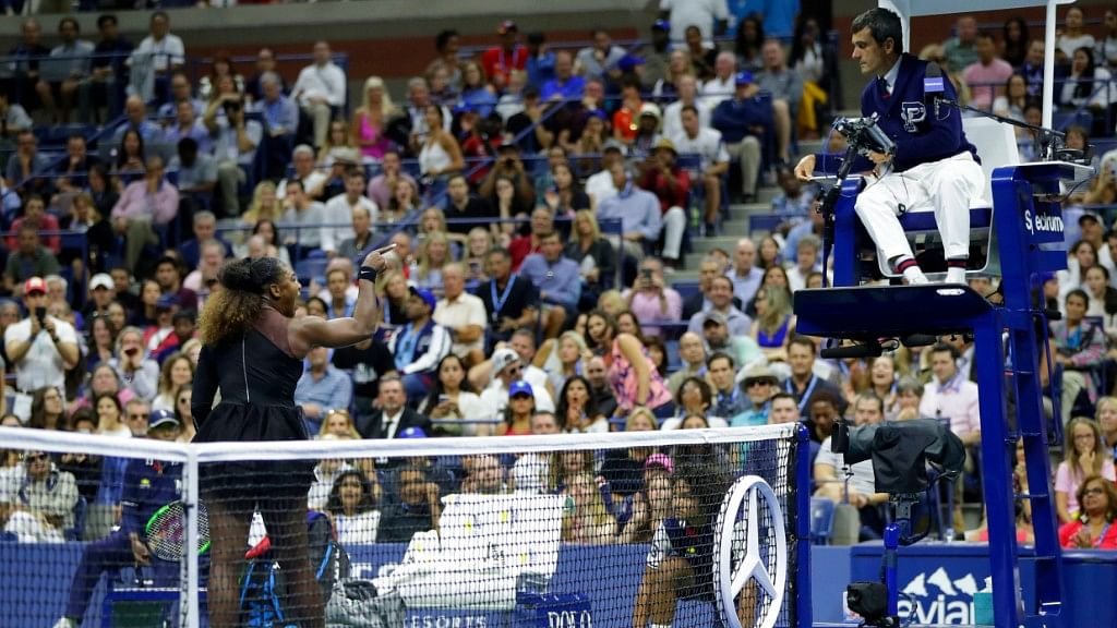 Serena Williams argues with chair umpire Carlos Ramos during her match against Naomi Osaka in the women's final of the US Open tournament on Saturday.
