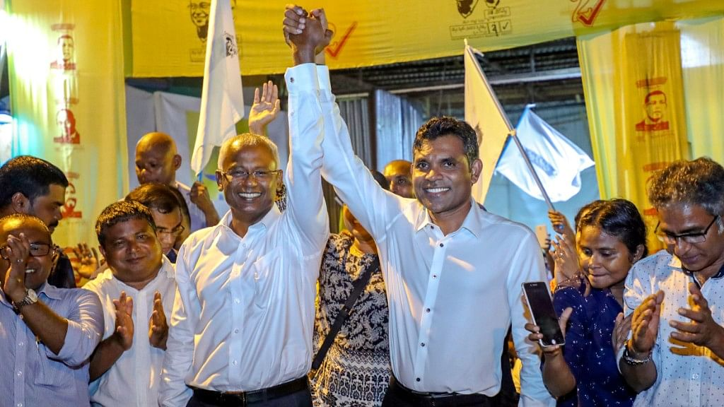 Maldives' opposition presidential candidate Ibrahim Mohamed Solih, third left, celebrates his victory.
