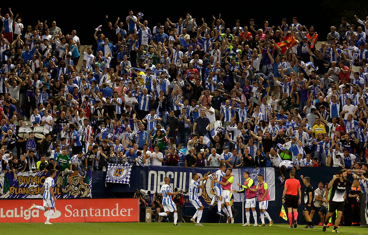 Leganes' players celebrate after scoring their second side's goal during the Spanish La Liga soccer match between Leganes and FC Barcelona at the Butarque stadium in Leganes, Spain, Wednesday, Sept. 26, 2018.