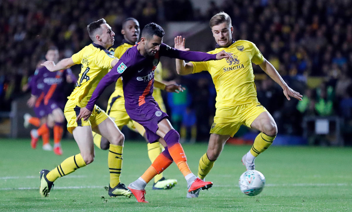 Manchester City's Riyad Mahrez shoots on goal to score his side's second goal during the English League Cup soccer match between Oxford United and Manchester City.