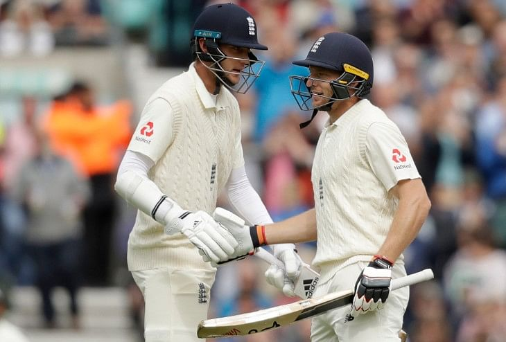 England's Jos Buttler (right) is congratulated by England's Stuart Broad after he reached his fifty at the Oval  in London on Saturday.