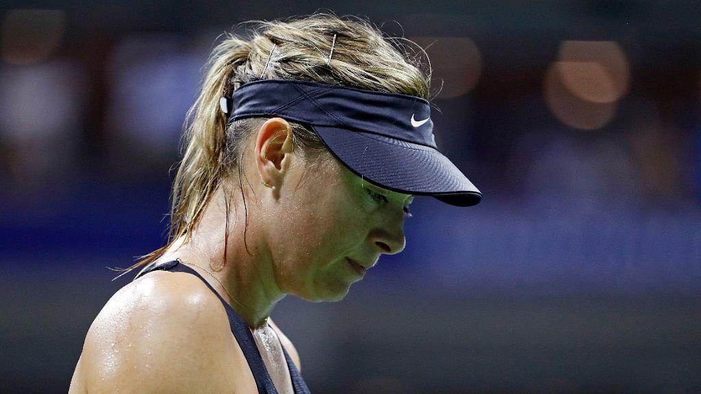 Maria Sharapova reacts after losing to Carla Suarez Navarro in the US Open.