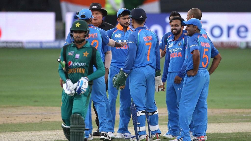 India's Kedar Jadhav celebrates with teammates the dismissal of a Pakistan batsman during their Asia Cup match in Dubai, United Arab Emirates on Wednesday.