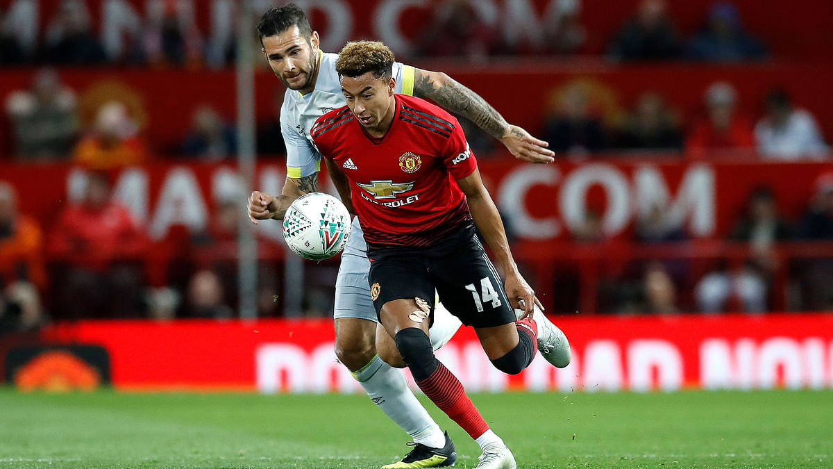 Derby County's Bradley Johnson, behind, runs after Manchester United's Jesse Lingard, during the English League Cup.