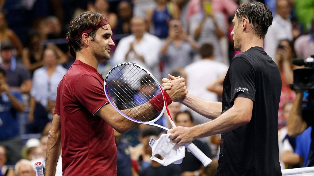Roger Federer and John Millman after their match.