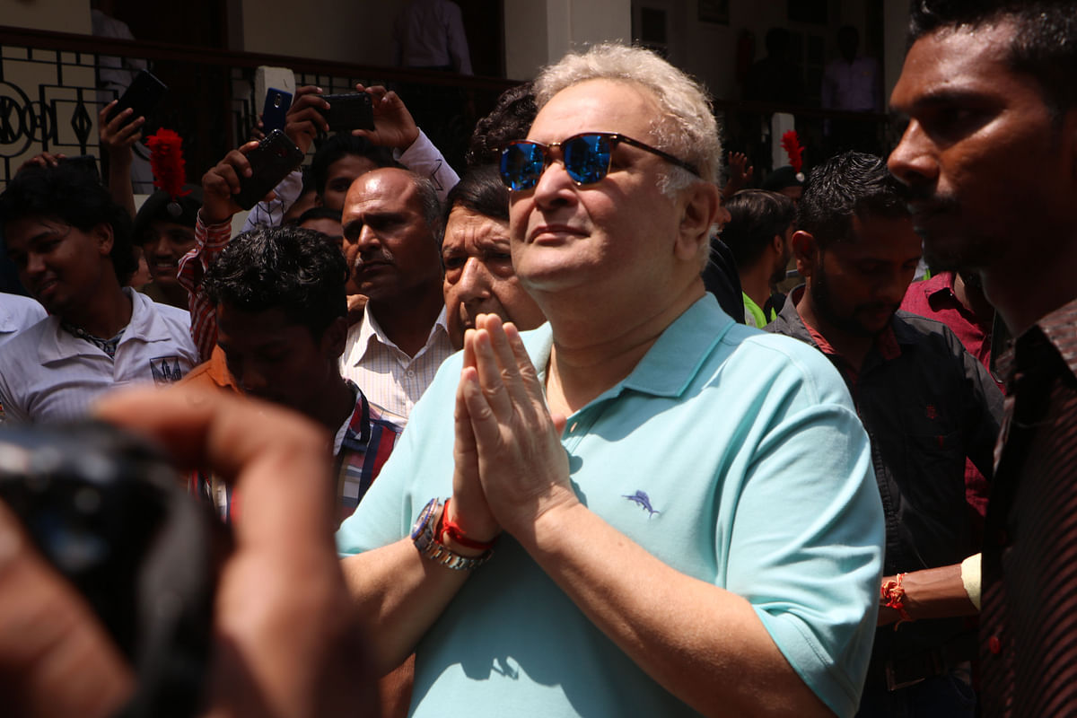 Rishi Kapoor joins his hands in a prayer before the procession begins.