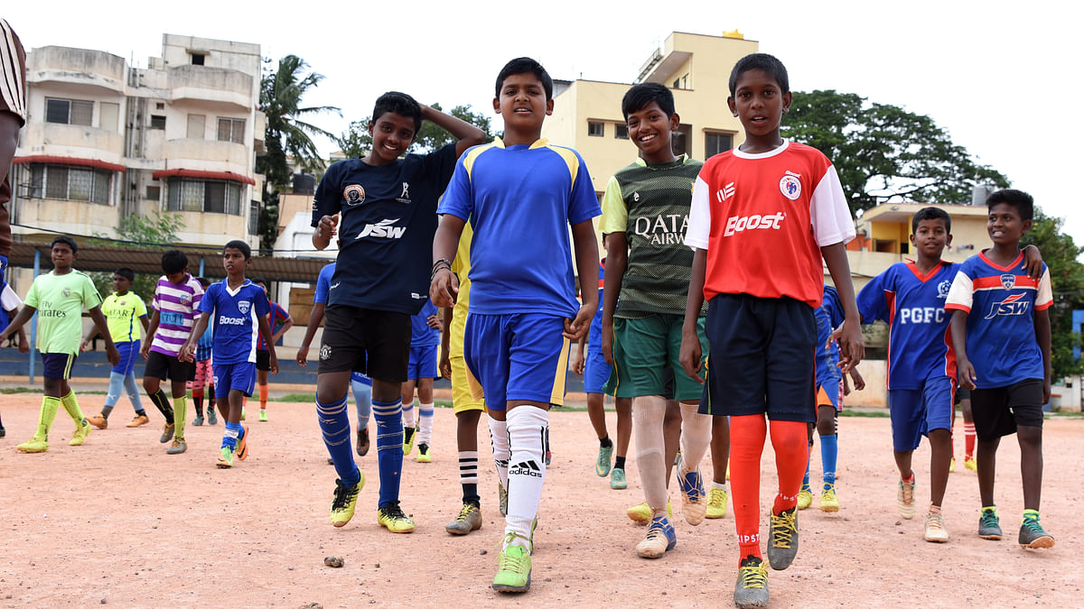 Young boys come out to play football in Bengaluru's Gowthamapuram that can easily pass off as a neighbourhood in Sao Paulo.