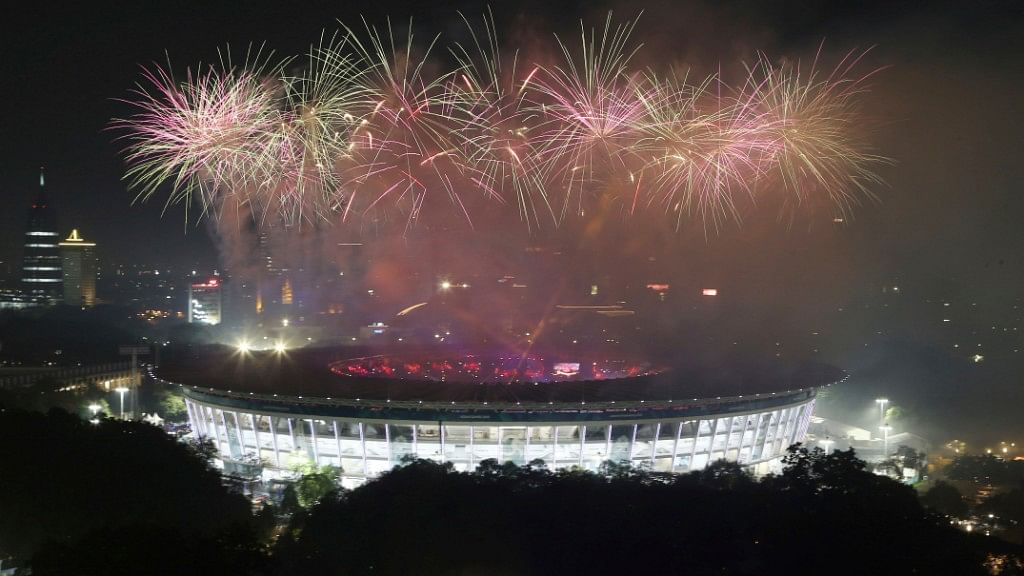 Fireworks explode during the closing ceremony for the 18th Asian Games in Jakarta.