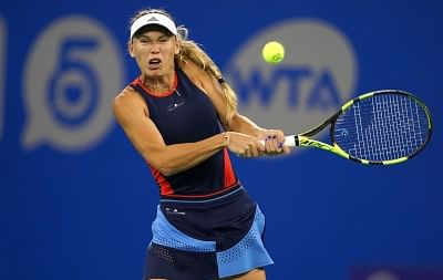WUHAN, Sept. 25, 2018 (Xinhua) -- Caroline Wozniacki of Denmark returns a shot to Rebecca Peterson of Sweden during their singles second round match at the 2018 WTA Wuhan Open tennis tournament in Wuhan of central China