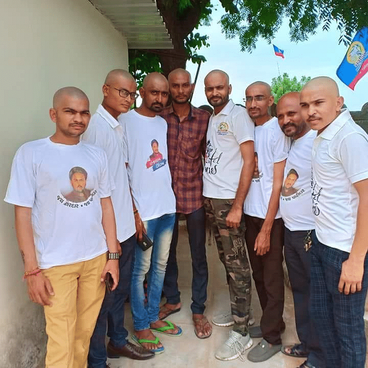 A group of Hardik Patel supporters shave their heads as a mark of solidarity.