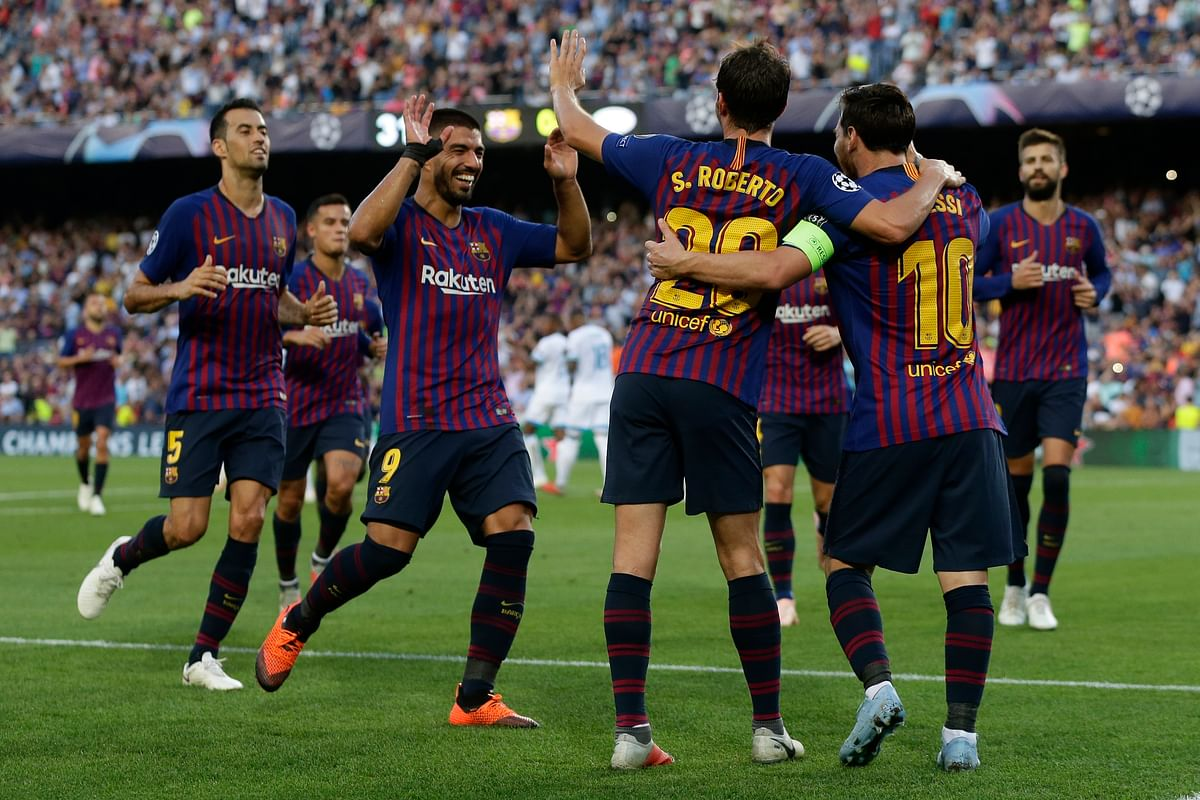 Barcelona players celebrate the opening goal of their team during the group B Champions League soccer match between FC Barcelona and PSV Eindhoven at the Camp Nou stadium in Barcelona, Spain, Tuesday, Sept. 18, 2018.