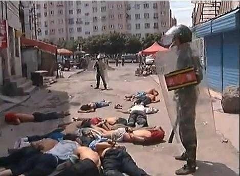 Chinese troops detain Uyghur Muslims in Xinjiang.