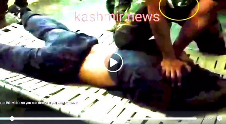 """The screengrab from the video has been modified for brightness by <a href=""""http://smhoaxslayer.com/mr-pak-journalist-the-irony-is-on-you/"""">SMHoaxSlayer</a>. One can see the Pakistani flag on the man's uniform."""