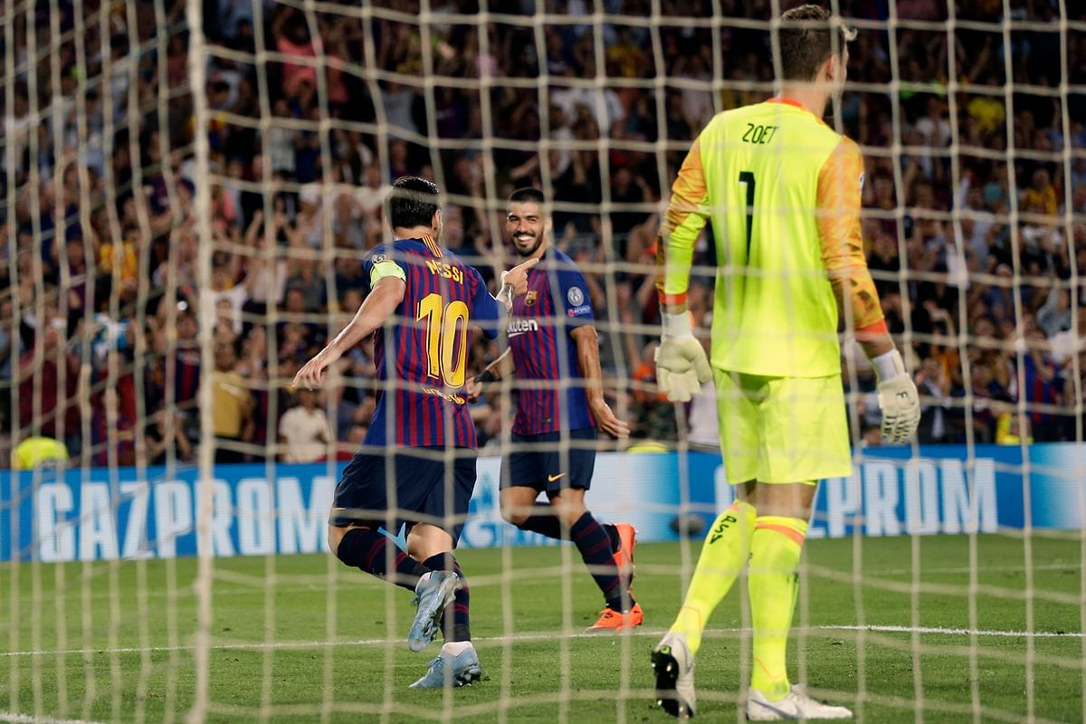 Barcelona forward Lionel Messi, left, celebrates after scoring his side's third goal during the group B Champions League soccer match between FC Barcelona and PSV Eindhoven at the Camp Nou stadium in Barcelona, Spain, Tuesday, Sept. 18, 2018.
